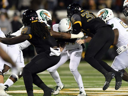 Southern Miss miss defense make a tackle in a game against UAB on Saturday at M.M. Roberts Stadium.