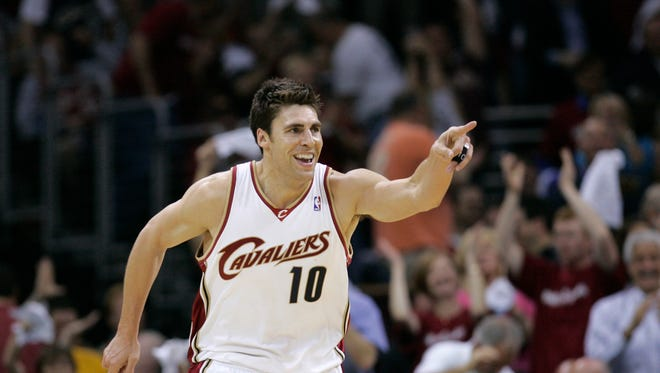 Former Cleveland Cavaliers forward Wally Szczerbiak celebrates a basket during an NBA Eastern Conference semifinal basketball game against the Atlanta Hawks Thursday, May 7, 2009, in Cleveland.