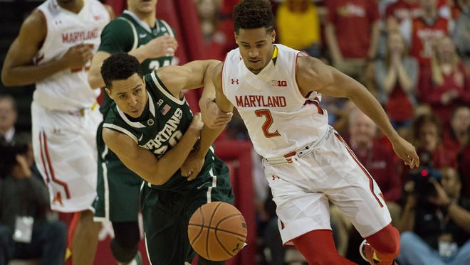 Michigan State guard Travis Trice and Maryland guard Melo Trimble battle for a loose ball during the second half Saturday. Maryland defeated Michigan State 75-59.