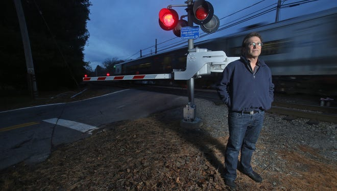 Alan Brody, the husband of Ellen Brody, the driver whose vehicle was struck by a Metro-North train in Valhalla in February, stands at the Commerce Street crossing Nov. 27. Ellen Brody's Mercedes SUV was struck at this crossing after she drove into the path of the oncoming train. Brody and five train passengers were killed. Alan Brody has taken up the issue of improving railroad crossing safety.