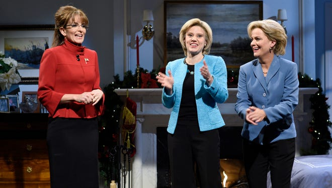 Tina Fey as Sarah Palin, Kate McKinnon as Hillary Clinton, and Amy Poehler as Hillary Clinton during 'A Hillary Christmas' sketch on 'SNL' on Dec.19, 2015.
