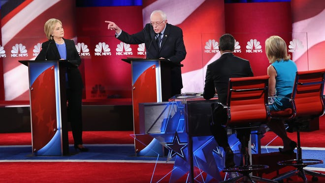 Hillary Clinton and Bernie Sanders field questions from moderators Lester Holt and Andrea Mitchell during the Democratic debate hosted by NBC News and YouTube on on Jan. 17, 2016 in Charleston, S.C.