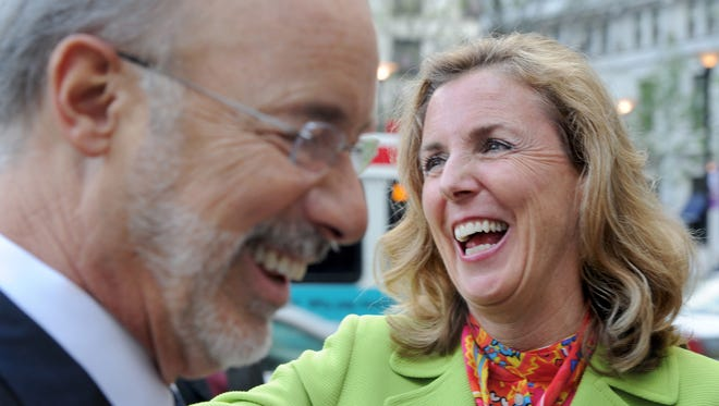 Katie McGinty, Democratic candidate for the U.S. Senate, right, campaigns with Gov. Tom Wolf, left, in Philadelphia, Tuesday, April 26, 2016.