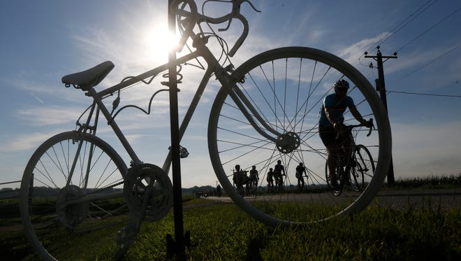 The ghost bike marks the start of the Mile of Silence during RAGBRAI XLIV along the route between Glenwood and Tabor, Sunday, July 24, 2016.