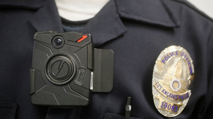 A Los Angeles Police officer wears an on-body camera