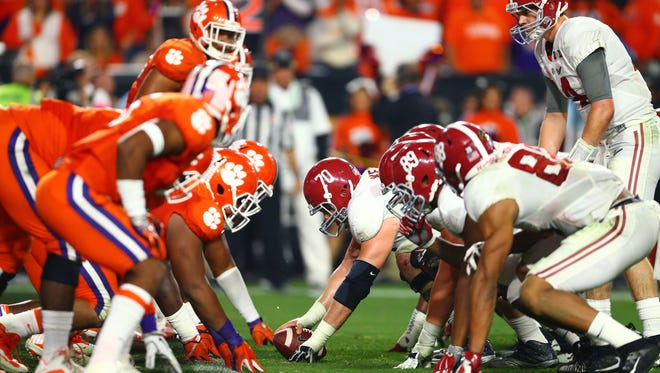 Alabama prepares to snap the ball against the Clemson in the College Football Playoff championship game at University of Phoenix Stadium on Jan. 11, 2016.