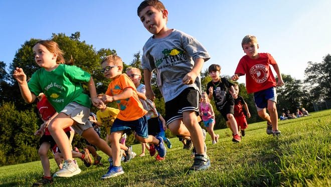 The start of the kindergarten fun run at the Junior Colonels Cross Country meet held at East Heights Elementary Tuesday, September 26, 2017.