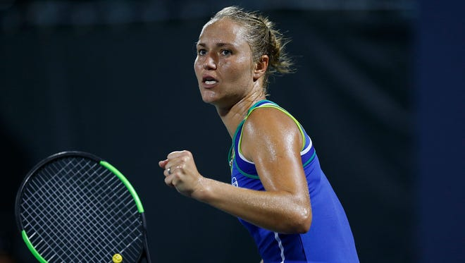 Kateryna Bondarenko of Ukraine celebrates a point against Francesca Schiavone of Italy.