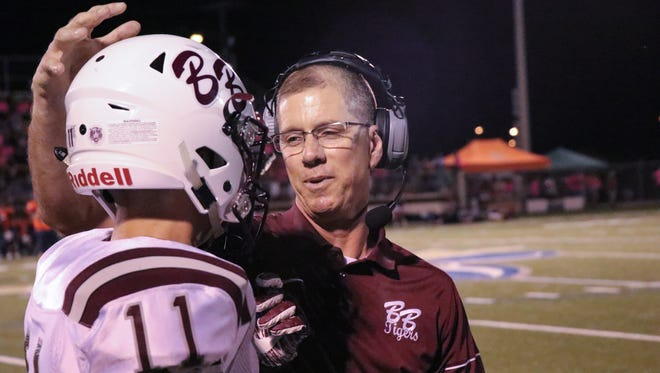 Breaux Bridge coach Terry Martin congratulates Nick Cornes (11) after a big play during last week's win over Beau Chene.