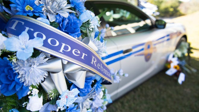 A memorial is set up by a patrol car for Trooper Daniel Rebman at Highway Patrol headquarters on Villa Road on Thursday, October 26, 2017.