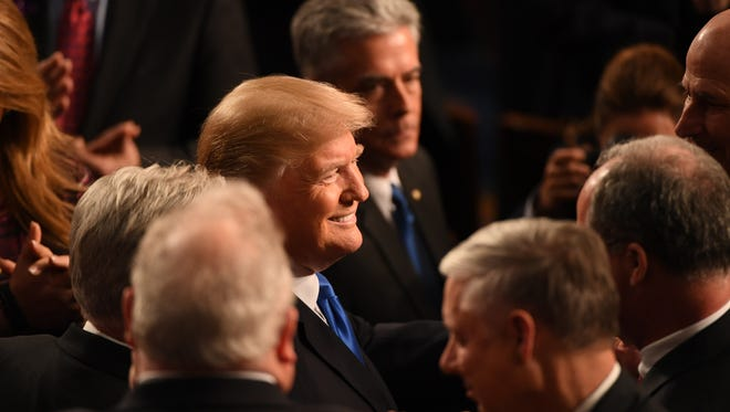 President Donald Trump greets members of congress before delivering the State of the Union address on Jan. 30, 2018 from the House chamber of the United States Capitol in Washington.
