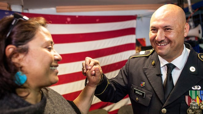 Hector Barajas, a deported U.S. Army veteran, right, celebrates with Norma Chavez-Peterson, executive director of the ACLU of San Diego and Imperial counties, after Barajas was delivered an announcement granting his U.S. citizenship in Tijuana, Mexico, on March 29, 2018.