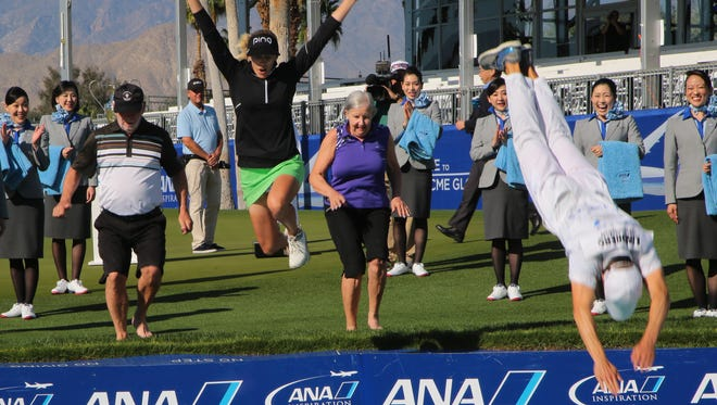 Pernilla Lindberg jumps into Poppie's Pond with her parents and fiancee and caddie, Daniel Taylor, after winning the ANA Inspiration in eight playoff rounds, Rancho Mirage, Calif., Monday, April 2, 2018.