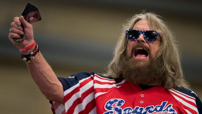 """Tony Slayden, originally of Mt. Juliet and now living in Berry Hill, cheers and rings a bell during the Nashville Sounds' 4-1 victory against the Iowa Cubs at First Tennessee Park on Friday, July 6, 2018, in Nashville, Tenn. Slayden is a member of the """"Foul Bells,"""" a group of Sounds fans that often ring cow bells while cheering for the team. He has been a regular attendee of Sounds games since 1987."""