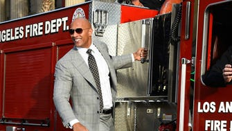 The Rock arrives at the 'San Andreas' premiere in fireman style