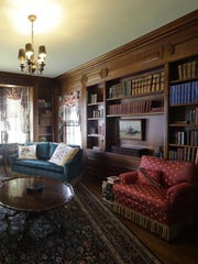 The library in the Sensenbrenner mansion reflects the luxury of the home.