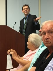 Attorney Todd Janzen looks into the audience during Thursday's BZA meeting in Muncie.