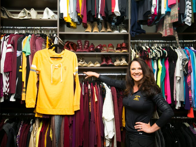 Penni Graham is seen in her closet with her ASU gear on Friday, Sept. 19, 2014, in Scottsdale.