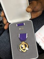 Oscar Evans was awarded a Purple Heart   for wounds received May 19, 1968 .