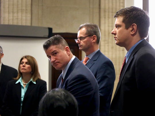 Chicago Police officer Jason Van Dyke, right, charged