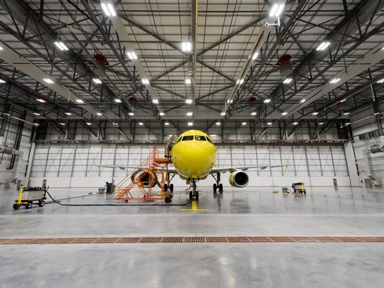 "An A320 ""operational spare"" airplane sits in the main hangar bay for the new maintenance hangar for Spirit Airlines."