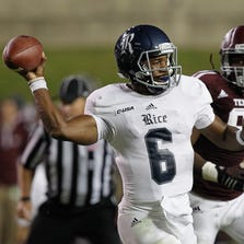 COLLEGE STATION, TX - SEPTEMBER 13:  Driphus Jackson #6 of the Rice Owls rolls out as he is pressured by Julien Obioha #95 of the Texas A&M Aggies at Kyle Field on September 13, 2014 in College Station, Texas.  (Photo by Bob Levey/Getty Images)