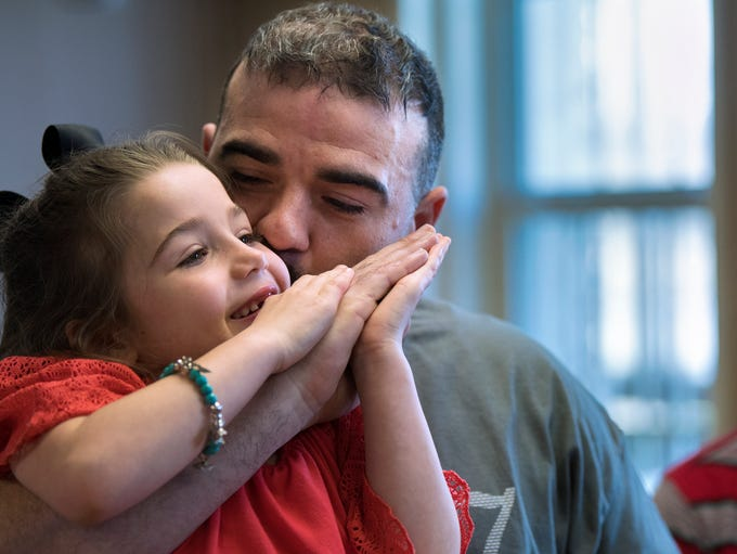 Inside/Out Dad graduate Ryan Mills kisses his 6-year-old