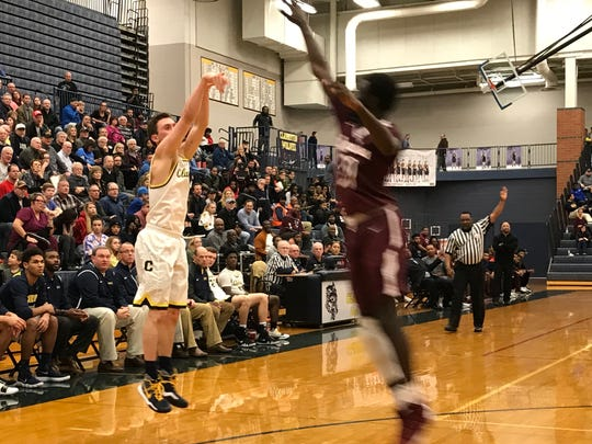 Clarkston's Foster Loyer puts up a shot over a Romulus defender on Feb. 20, 2018.