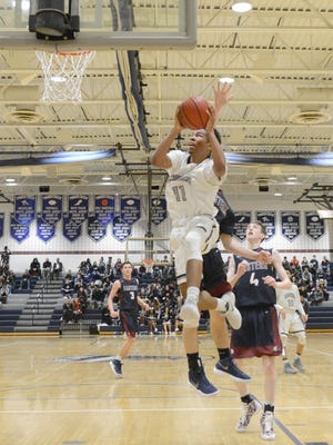 Timber Creek's Sean Miller takes the ball to the hoop during Tuesday's 79-67 victory over Eastern.