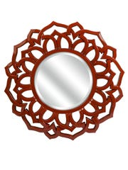This photo provided by Overstock.com shows a Calantha mirror. The rich deep red of this Calantha wall mirror from Overstock is one of the major color trends for 2015.