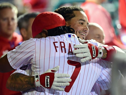 Freddy Galvis gets a hug from third baseman Maikel Franco after hitting a home run in an April game.