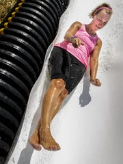 Sleepy Hollow hosted its annual Beer Run event in support of Leukemia and Lymphoma Society July 9. Participants enjoyed a variety of games and activities, music and beverages. Kelley Keltong slides fast along the tubing of the waterslide.