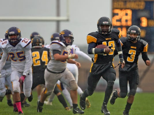 Solanco's Troy Miller breaks free against Lancaster Catholic during the Mules 48-6 win on Friday, October 2, 2015.