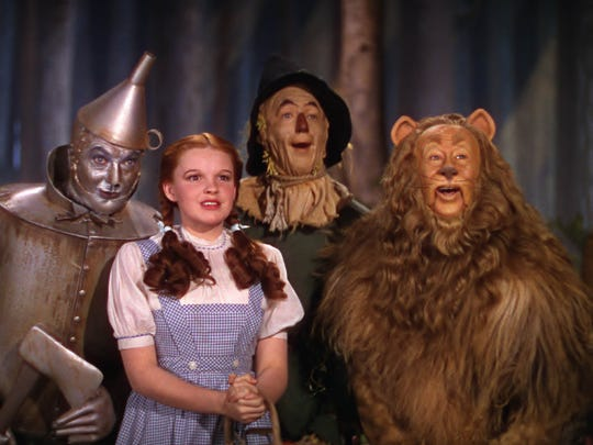 """Jack Haley, from left, Judy Garland, Ray Bolger and Bert Lahr appear in a scene from the motion picture """"The Wizard of Oz."""""""