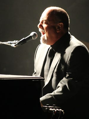 Artist Billy Joel performs at the Paramount for the Long Island Cares Harry Chapin Food Bank on Wednesday, Oct.16, 2013 in Huntington, New York.