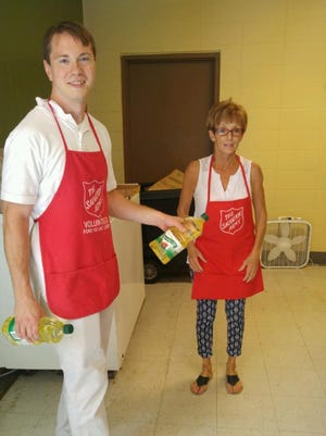 Scott Erdman and Jackie Schoenborn volunteer at The Salvation Army of Fond du Lac.