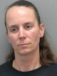 Christina Jarman was charged with  theft less than