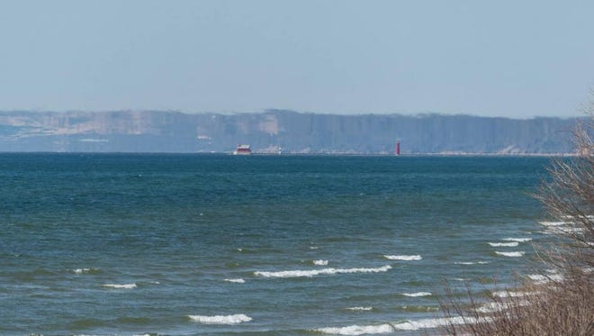 A mirage could be seen on the horizon of Lake Michigan from Grand Haven on Saturday. Atmospheric conditions were favorable to allow the phenomenon to take place.