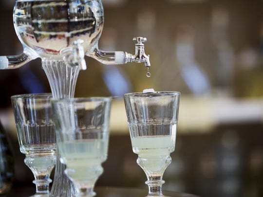 A glass of absinthe is prepared at VOM FASS at the Mercato Shops in Naples.