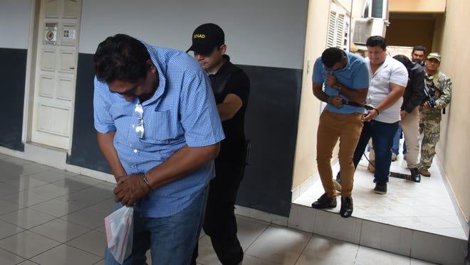 Four men presumably linked to the Sinaloa cartel are arrested in Asuncion, Paraguay, on Dec. 9, 2016.