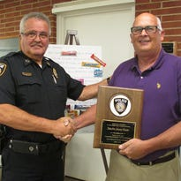 Ashland City Police Chief Marc Coulon, left, presents a plaque to retiring Detective Johnny Hunter. A retirement reception was held in Hunter's honor on Aug. 25.