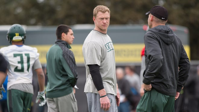 Jan 10, 2015; Euless, TX, USA; Oregon Ducks offensive coordinator Scott Frost (left) and head coach Mark Helfrich (right) watch their team during practice at the Euless Trinity High School football field. Mandatory Credit: Jerome Miron-USA TODAY Sports