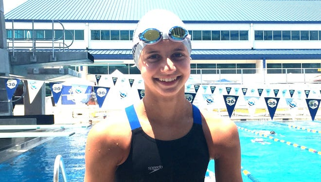 Kate Douglass, who set a national record for 13-year-olds in the 50-meter freestyle