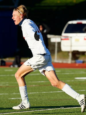 Mendham senior Hans Gallagher celebrates after scoring on Hopewell Valley in the NJSIAA North 2 Group III boys soccer sectional final.