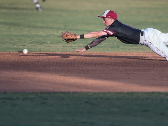 Mt. Whitney's Tyler Hinkley goes after a hit ball from