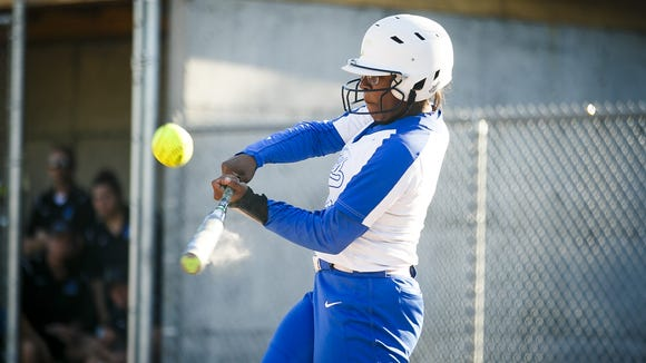 McNary's Nadia Witt gets a hit against Grant High School in the first round of the OSAA 6A state playoffs on Monday, May 22, 2017, at McNary High School in Keizer, Ore. McNary defeated Grant 18-14.