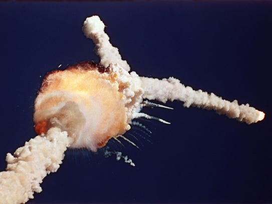 Space shuttle Challenger explodes shortly after lifting