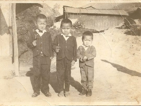 Law Toua, Law Lue (Pao) and Law Xang Xiong pose for a picture in Long Cheng Laos in 1970.