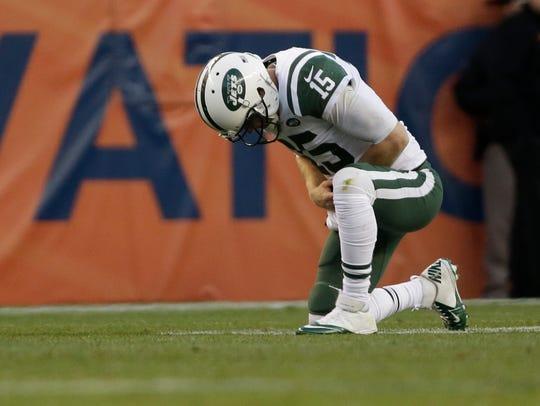 New York Jets quarterback Josh McCown (15) takes a