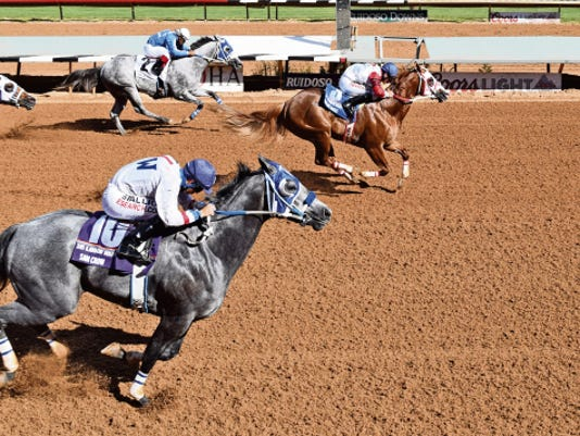 Courtesy Photo - Ruidoso Downs. Kiss My Hocks (3) crosses the wire a half-length in front of Sam Crow (10) in Saturday's 900,000 Rainbow Derby at Ruidoso Downs.
